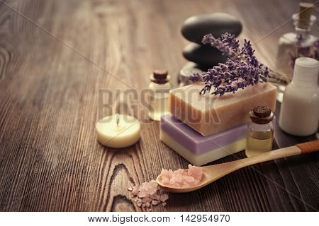 Spa composition with lavender, soap and oil on wooden background