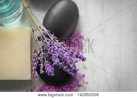 Spa composition with lavender, stones and soap on white wooden background