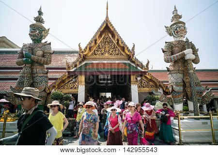 BANGKOK THAILAND - MARCH 9 2016: Chinese tourists at Wat Phra Kaew The most famous tourist attraction in Bangkok Thailand.