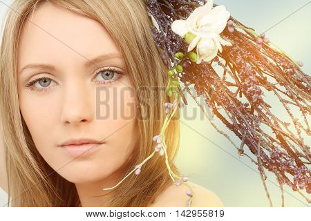 Spring beautiful woman portrait on sunlight background