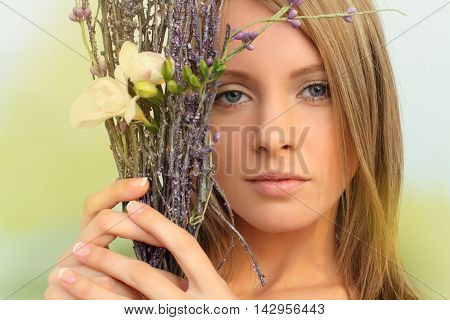 Glamour beautiful woman spring fashion concept on green background