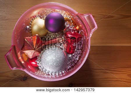 Christmas decoration in a pink champagne cooler on a wooden floor