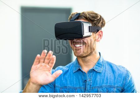 Young man using the virtual reality headset at office