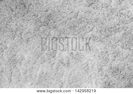 Closeup surface abstract fabric pattern at the gray fabric carpet at the floor of house texture background in black and white tone