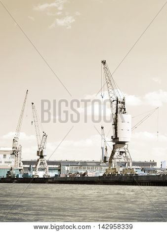 Shipyard or container harbor with harbor cranes.