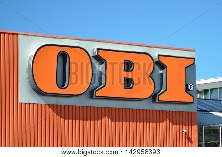 CIRCA AUGUST 2016 - GDANSK: sign of OBI against blue sky. OBI is the largest do it yourself retailer in Europe. It was founded in 1970 in Hamburg, Germany.