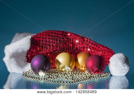 Colorful christmas balls santa head and bead chain with reflections