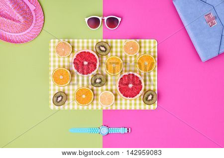 Fashion. Summer Accessories fashion set. Tropical Fruit Citrus, Orange, Grapefruit Lime Kiwi. Fashion woman Glamor Wrist Watches, Trendy Sunglasses. Stylish girl. Fashion creative concept. Minimal Art