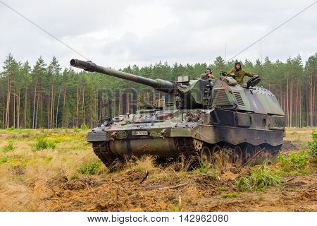 PABRADE / LITHUANIA - AUGUST 9, 2016: german Panzerhaubitze 2000 armoured howitzer 2000 drives on multinational exercise