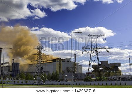 steel plant pollutes the environment with clouds of red smoke. The environmental problem.