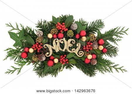 Christmas decoration with gold noel sign, bauble decorations, holly, ivy, pine cones, cedar cypress and fir leaf sprigs over white background.
