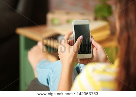 Girl listening to music with smart-phone