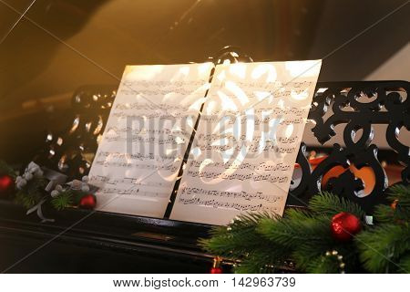 Music notes on piano with Christmas decoration