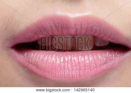 beauty woman lips and decayed yellow tooth with isolated white background asian