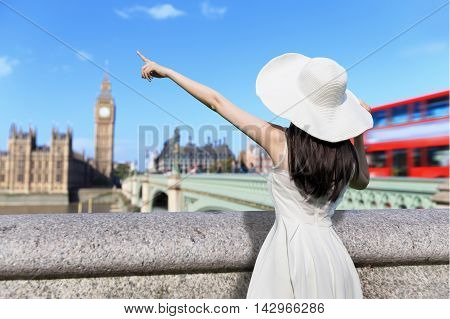 young woman wear dress and smile with Big Ben in london UK