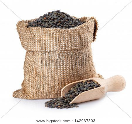 black beluga lentils in burlap bag with wooden scoop isolated on white background. Black beluga lentils. Super food