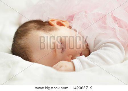 Sweet beautiful little baby girl face closeup
