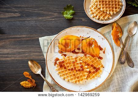 Delicious dessert : Caramelized pears with waffles and caramel sauce