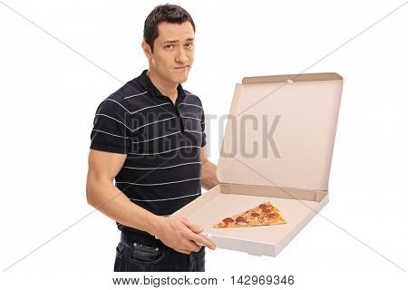 Disappointed young man holding a pizza box with one slice of pizza isolated on white background