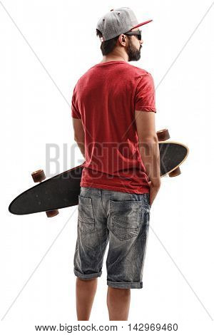 Bearded man holding a longboard isolated on white background
