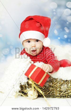 New Year and Christmas background happy baby in Santa hat
