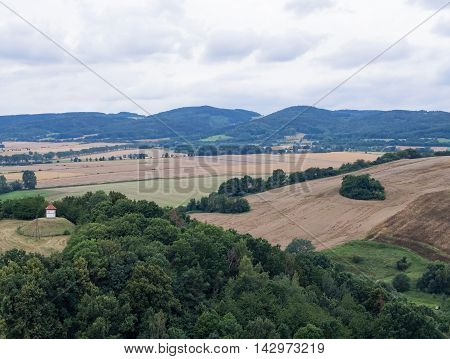 Beautiful hilly landscape with tower field and trees in Silesia Poland
