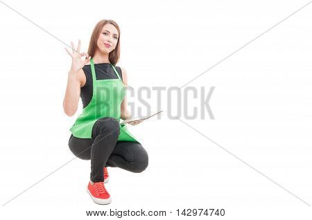 Young Female Seller Doing Ok Sign