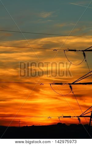 Sky at sun set on the Pennines, taken at dusk in August. The view across the sky shows a beautiful coloured sky, pinks, blues, oranges, whites, the horizon silhouetted in the background with the pylon.