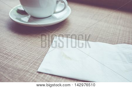Vintage Filter : Tissue Paper With Coffee Stain On Wood Table