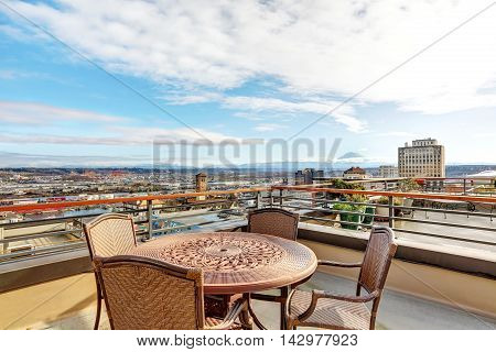 Patio Area With Table, Chairs On Walkout Deck Overlooking Scenic View