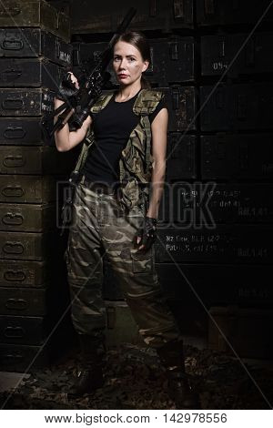 Girl In The Black T-shirt With A Gun