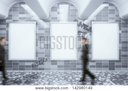 Metro station with empty ad posters hanging on dark grey tile wall blurry businessmen walking by. Mock up 3D Rendering