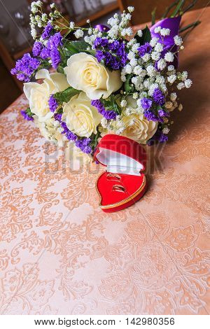 wedding rings in a red case. wedding. newlyweds. gold rings. Lord of the Rings. gold.