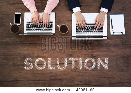 Business training concept. Man and woman working on laptops