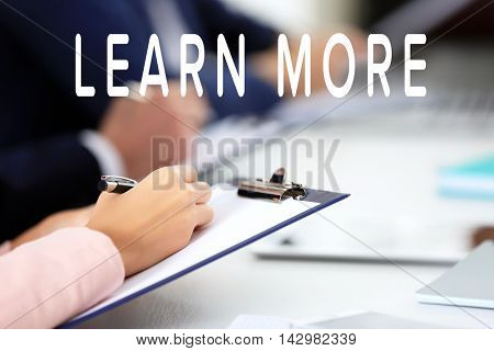 Business training concept. Woman's hand making notes