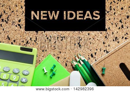 Business training concept. Stationery on cork board background.