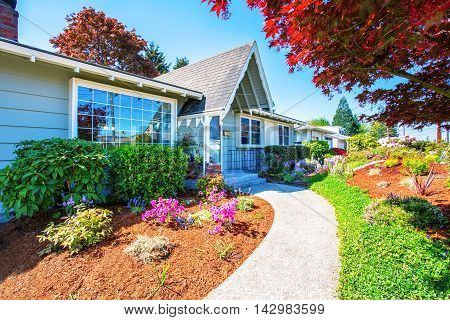 Small Light Blue American House Exterior With French Windows.