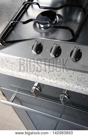 close up shot of stove and oven in domestic kitchen