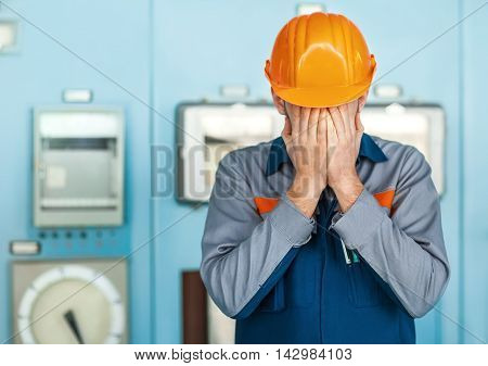 Stressed Engineer Closed Face By Two Hands