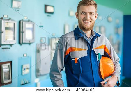 Young Happy Engineer In Control Room