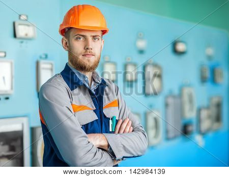 Young Engineer At Control Room In Factory