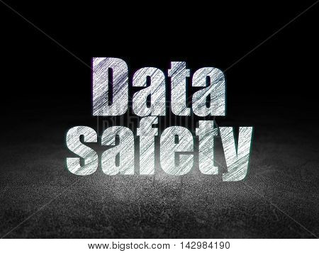 Information concept: Glowing text Data Safety in grunge dark room with Dirty Floor, black background