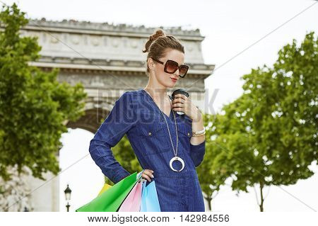 Fashion-monger With Shopping Bags Near Arc De Triomphe In Paris