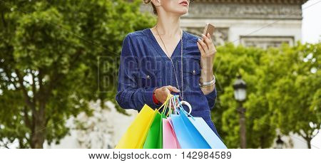 Elegant Woman With Shopping Bags Holding Smartphone, Paris