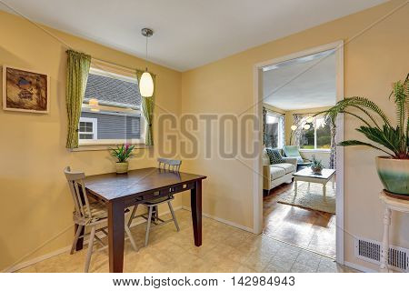 Dining Area With Table Set And Nice Green Curtains.