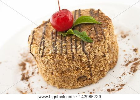 Layered Cake With Nut On Plate, On White Background. Selective Focus