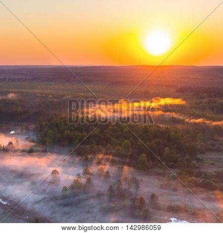 Foggy sunrise over river Biarezina, Belarus