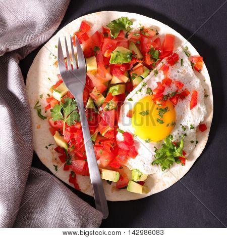 fajita with tomato,paprika and fried egg