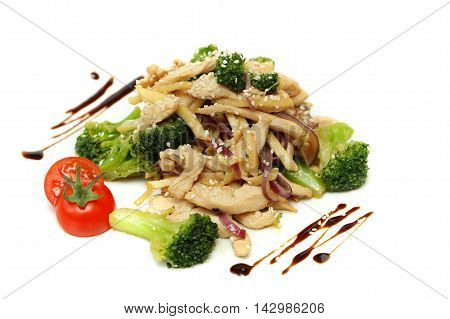 Wok - Asian stir fry with pork vegetables bean sprouts and sesame seeds on white