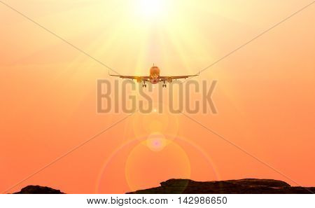 Airplane and sunbeam with lens flare effect on orange background